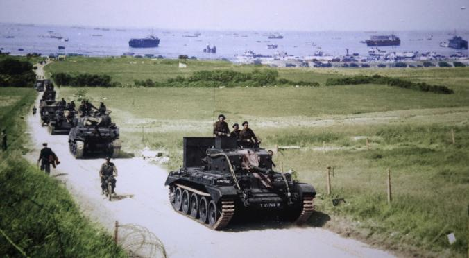 A Cromwell tank leads a British Army column from the 4th County of London Yeomanry, 7th Armored Division, inland from Gold Beach after landing on D-Day in Ver-sur-Mer, France, on June 6, 1944. (REUTERS/US National Archives)